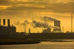 Power plant at sunrise Stock Image