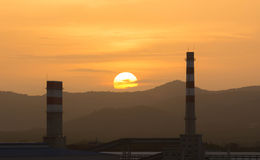 Power plant in sunset. Stock Photos