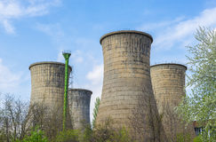 Power plant towers in spring green landscape and blue sky Royalty Free Stock Photos