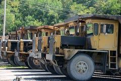 Power plant transport trucks Stock Photography