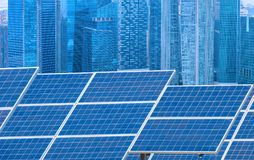 Power plant using renewable solar energy with city building back Royalty Free Stock Photography