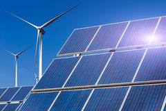 Power plant using renewable solar energy with sun and wind turbine Stock Images