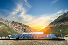 Power plant using renewable solar energy. With sunset over the Gap in the Himalayan Mountain, Kashmir, India Royalty Free Stock Photo