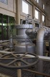 Power plant valves. Control wheel and steam tubes from power station Royalty Free Stock Photography