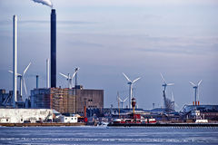 Power plant and vertical axis wind turbines in the sea port Royalty Free Stock Photography