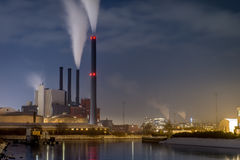 Power plant on water front by night in city Royalty Free Stock Photography