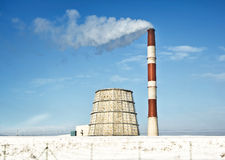 Power plant in winter sunny day Royalty Free Stock Images