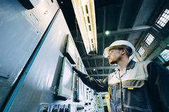 Power plant worker. Energy industrial factory inspector expertise Stock Image