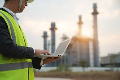 Power Plant Worker With Notebook Computer. Industrial worker with notebook working in a power plant stock photos
