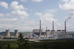 Power plants, cooling towers, chimneys, grassland Royalty Free Stock Image
