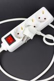 Power plug. And electrick outlet on blak background Royalty Free Stock Photo