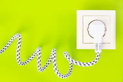 Power plug gets green energy from power socket stock image