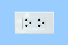 Power plug isolated on blue background. Royalty Free Stock Photography
