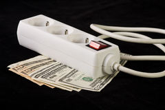 Power plug and money concept energy costs Stock Photos