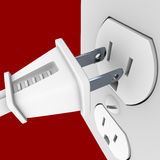 Power Plug and Outlet. A white electrical power cord about to plug into a wall outlet Royalty Free Stock Image