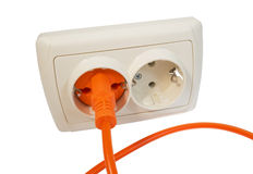 Power plug into power outlet Royalty Free Stock Photography