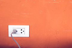 Power plug and socket on wall Royalty Free Stock Photos