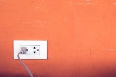 Power plug and socket on wall Royalty Free Stock Photos