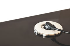 Power Plugin. Details of a modern electric plugin built-in table Royalty Free Stock Image