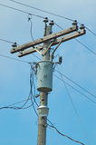 Power Pole. Wooden power pole with transformer and security light Stock Photos