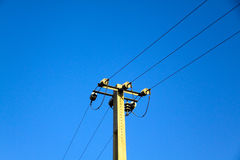 Power pole against the blue sky Royalty Free Stock Photo