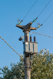 Power pole with electric transformer blue sky in background Royalty Free Stock Photos