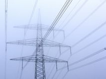 Power pole in fog Stock Photo