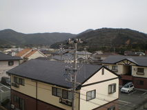Power pole and homes (Japan) Stock Photo