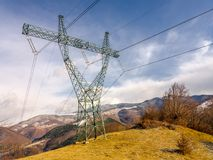 Power pole on the mountain. Electricity transmission pole on the mountain Stock Photo