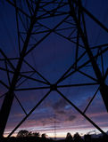 Power pole at night. Power pole in the last evening light Royalty Free Stock Photo