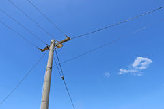 Power pole and power lines. In a blue sky stock images