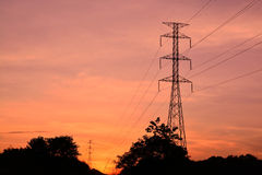 Power Pole Romance. Electricity Pylons in the Setting Sun Royalty Free Stock Images
