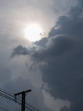 Power Pole with The Sun Gray Cloud. Before Rain Stock Images