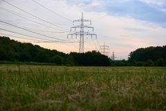 Power pole in a sunset stock images