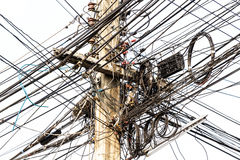 Power pole tangle. Power pole with Tangle of Electrical wires Stock Photos