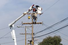 Power pole worker Stock Images