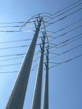 Power poles. Against blue sky Stock Photos
