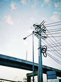 Power poles along the freeway Royalty Free Stock Images