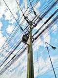 Power poles along the road in thailand Royalty Free Stock Photography