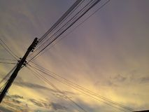Power poles and beautiful sky light of sunset stock image
