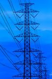 Power poles and cables, high voltage vertical . High voltage power pole at large . With blue sky Royalty Free Stock Image