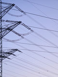 Power poles at dusk. On a clear summer evening Stock Images