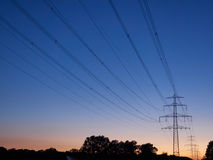 Power poles at dusk. On a clear summer evening Royalty Free Stock Image