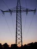 Power poles at dusk. On a clear summer evening Stock Photography