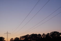 Power poles at dusk. On a clear summer evening stock photo