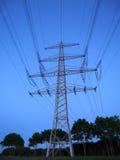 Power poles at dusk. On a clear summer evening stock photos