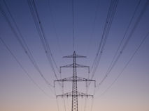 Power poles at dusk. On a clear summer evening Royalty Free Stock Photos