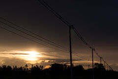 Power poles in the evening in the countryside. stock image
