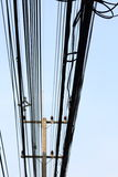 Power poles and many telephone lines. Royalty Free Stock Image