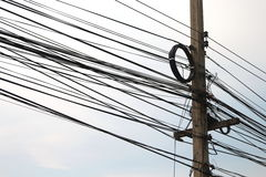 Power poles and many telephone lines. Stock Image